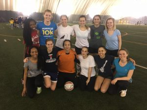 The women's soccer team look surprisingly happy after a heartbreaking loss in the Division 1 Championship match.